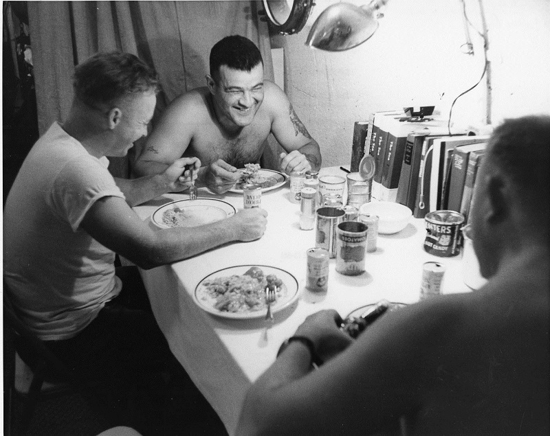 Aquanauts enjoying a meal in SeaLab 1 submerged off Bermuda in 1964: